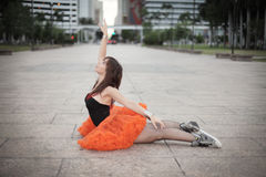 Ballerina stretching in a swan pose Royalty Free Stock Images