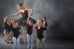 Ballerina teach girls stock photos