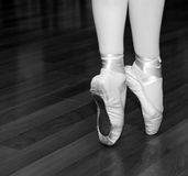 Ballerina on tip of toe. Portrait of beautiful legs ballet dancer on tip of toe royalty free stock images