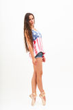 Ballerina in top colors of USA flag, jeans Stock Photo