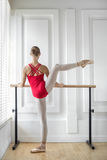 Ballerina is training on barre Stock Photography