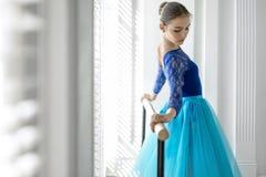 Ballerina is training on barre Stock Photos