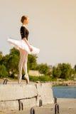 Ballerina in tutu dancing on the promenade. Royalty Free Stock Photos