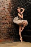 Ballerina in tutu near brick wall Royalty Free Stock Photo