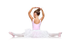 Ballerina in tutu sitting on floor Royalty Free Stock Photos