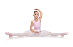 Ballerina in tutu sitting on floor Stock Images