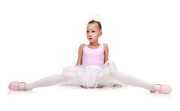 Ballerina in tutu sitting on floor Stock Photo