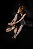 Ballerina tying pointe shoes. Stock Photography