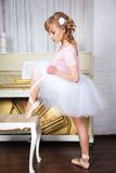 Ballerina tying pointe shoes Stock Image