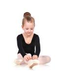 Ballerina tying pointe Stock Photo