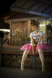 Ballerina in an urban nighttime setting Royalty Free Stock Photography