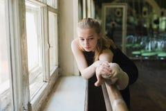 Ballerina warming up in ballet class Stock Photo
