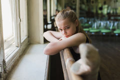 Ballerina warming up in ballet class Royalty Free Stock Photo