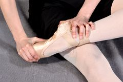 Close-up of a ballerina feet in pointe. Ballerina warming up feet before the rehearsal. Classical school of ballet stock photos