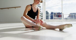 Ballerina wearing ballet shoes stock video