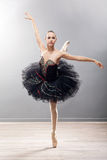 Ballerina is wearing a black tutu and pointe shoes Royalty Free Stock Photo