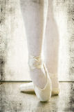 Ballerina wearing dancing shoes. Ballerina wearing dancing trainer shoes in the studio, filter applied Royalty Free Stock Photos