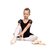 Ballerina wears ballet shoes Royalty Free Stock Photo