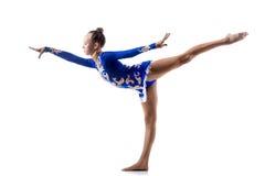 Ballerina working out. Beautiful ballerina teenage girl wearing dancer blue leotard working out, dancing, posing, doing balance art gymnastics exercise, standing stock images