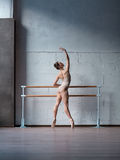 Ballerina. Young beautiful ballerina warming up in ballet class stock images