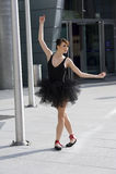 Ballerina in zwarte tutu Stock Foto