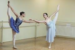 Ballerinas in a dance studio. Two ballerinas practicing ballet in the dance studio stock photos