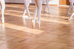 Ballerinas dancing in the ballet hall Stock Images