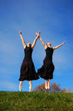 Ballerinas dancing in field Stock Photo