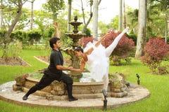 Ballerinas dancing in a garden Stock Photo