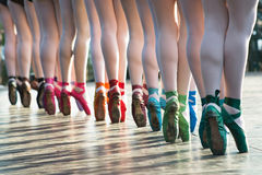 Ballerinas feet dancing on ballet shoes with several colors on s. Tage during a performance royalty free stock photography