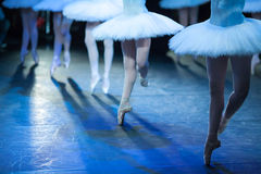 Ballerinas in the movement. Feet of ballerinas close up. Royalty Free Stock Images