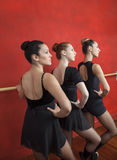Ballerinas Practicing At Ballet Barre In Dance Studio Royalty Free Stock Images