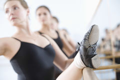 Ballerinas Practicing At The Barre Stock Photo