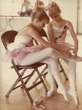 Ballerinas, Putting on our toe shoes. Two young girls helping each other put on toe shoes for ballet Stock Image