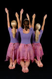 Ballerinas Raising Arms Stock Photo