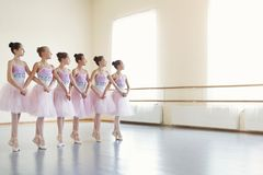 Ballerinas rehearsing dance of little swans in class. Copy space royalty free stock images