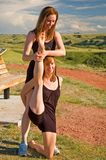 Ballerinas stretching Stock Images