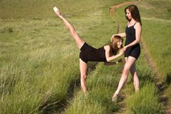 Ballerinas stretching Stock Photography