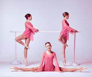 Ballerinas stretching on the bar Royalty Free Stock Images