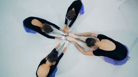 Ballerinas stretching together in a room, top view. stock video