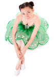 Ballerine. Sitting ballerina in green dress isolated on white background Stock Photos