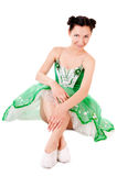 Ballerine. Smiling ballerina in green dress  on white background Royalty Free Stock Image
