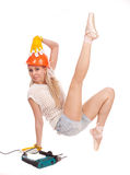 Ballerine dans le casque orange Photographie stock
