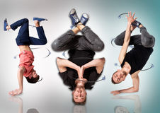 Ballerini della rottura che fanno verticale contro il fondo bianco Fotografia Stock Libera da Diritti