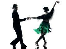 Ballerini eleganti delle coppie che ballano siluetta Immagini Stock