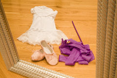 Ballet. Tutu, shoes and ribbon viewed through a mirror Royalty Free Stock Photography