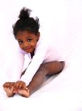 Ballet. A young black dancer stretches before she dances Royalty Free Stock Images