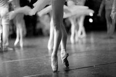 Ballet. Ballerina and ballet dancers on stage during a performance Stock Photo