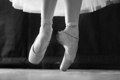 Ballet. The ballerina performs the dance movement at the rehearsal in the theater Stock Photography