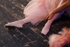 Ballet. A ballerina in the rehearsal hall of the theater. Minute of rest Royalty Free Stock Photos